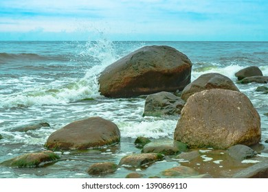 rocky sea shore, the wave beats against the stones