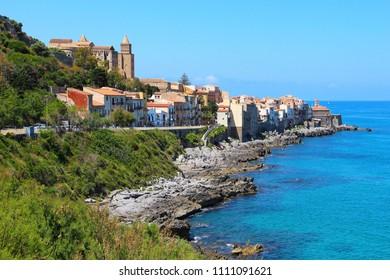 Rocky seacoast of Cefalu and beautiful Mediterranean sea on Sicily, Italy