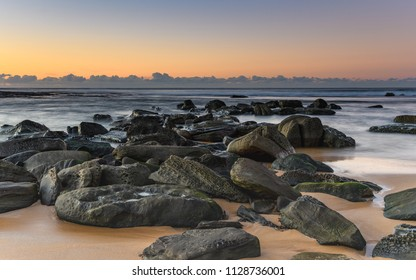 Rocky Seascape - Capturing the sunrise from Forresters Beach on the Central Coast, NSW, Australia.
