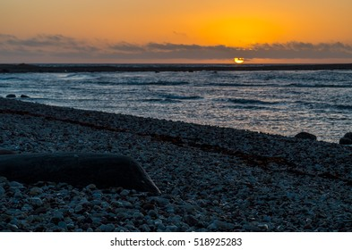 Rocky seascape. Composition of nature at sunset on rocky beach.