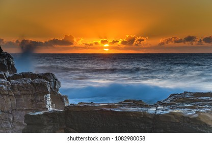 Rocky Seascape with Sun Rising - Capturing the sunrise from North Avoca Beach on the Central Coast, NSW, Australia.