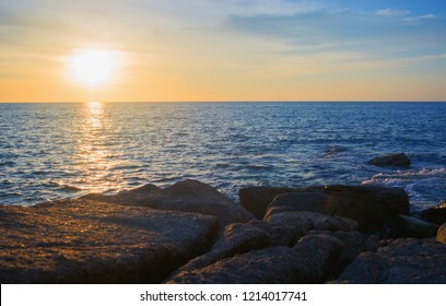 Rocky seashore and sunset over the sea