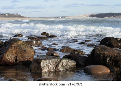 Rocky seashore and waves on a sunny winter's day