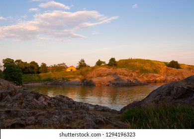 The rocky shore and bay of Suomenlinna Island in the Gulf of Finland is a beautiful traditional landscape of Finland, a summer evening in Finland.