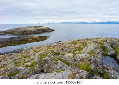 Rocky shore in Nordland county, Norway. The 'Lofoten Wall' in the background