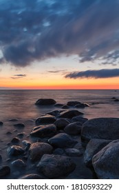 Rocky shore and peninsula of Baltic sea at sunset. Nordic minimalistic wilderness.