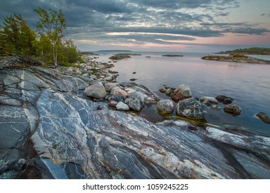 Rocky shore. Stones with divorces. Lake Shore. Ladoga lake. Karelia. Russia. Nature of Karelia. Nature of Russia.