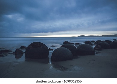 Rocky shore sunrise at New Zealand