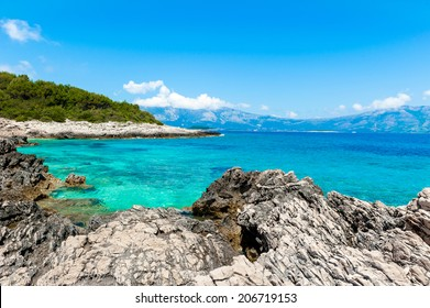 Rocky shore with turquoise sea water. Adriatic coast of Korcula island, touristic destination in Croatia.