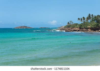 rocky shoreline and islands of atlantic ocean along north coast puerto rico near arecibo