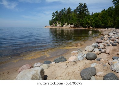The rocky shoreline of Lake Superior and Mosquito Beach along the Pictured Rocks National Lakeshore in the Upper Peninsula of Michigan.