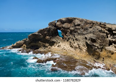 rocky shoreline and ocean at puntas las tunas and cueva del indio of north coast puerto rico