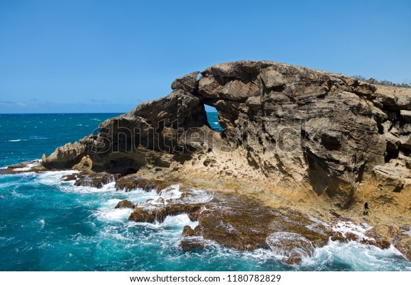 rocky shoreline and ocean at puntas las tunas and cueva del indio of north coast puerto rico