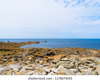 A rocky shoreline on the Celtic Sea in Brittany, France
