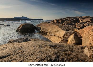 Rocky shoreline on the edge of town in Qikiqtarjuak, Nunavut, Canada