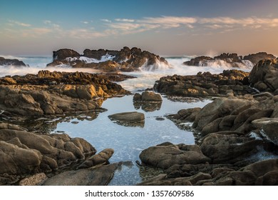 Rocky shoreline with tidal pools and waves