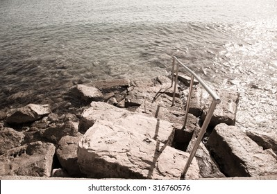 The rocky slope to the waterfront to the water of the Mediterranean Sea. Toned.