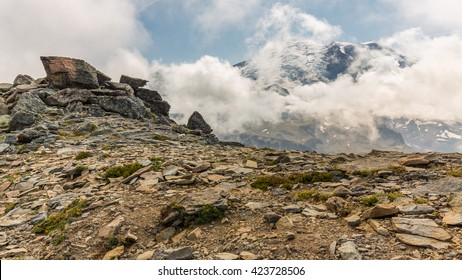 Rocky slopes in the mountains. Amazing view at the peaks which rose against the cloud sky. Path on the tops of mountains. MOUNT FREMONT LOOKOUT TRAIL, Sunrise Area, Mount Rainier