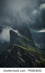 Rocky steep mountains and cliffs in the clouds