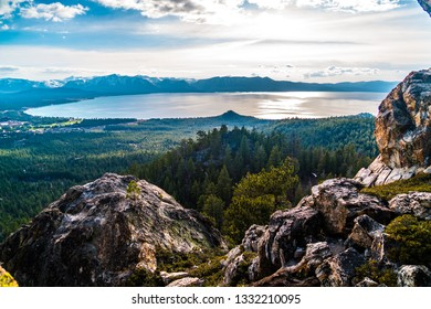 Rocky summit on top of Castle Rock peak Sierra Nevada mountains and Lake Tahoe Wilderness in enchanted thick forest of pine trees and sequoia trees in Northern California