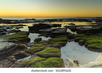 Rocky Sunrise Seascape - Capturing the sunrise from Caves Beach on the Swansea Peninsula, Central Coast, NSW, Australia.