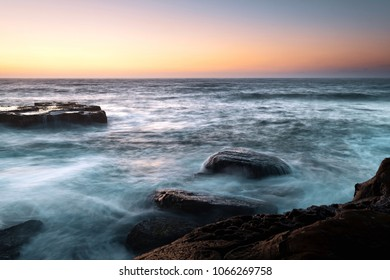 Rocky Sunrise Seascape - Capturing the sunrise from North Avoca Beach on the Central Coast, NSW, Australia.