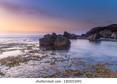 Rocky Sunrise Seascape - Forresters Beach on the Central Coast, NSW, Australia.