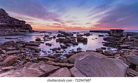 Rocky Sunrise Seascape - The Skillion at Terrigal, Central Coast, NSW, Australia.