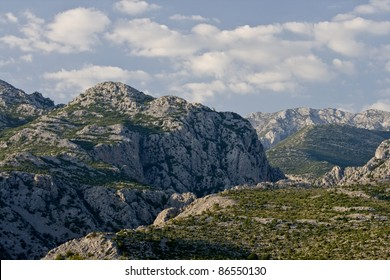 Rocky tops of the national park Paklenica and the clouds
