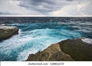 Rocky tropical ocean seashore