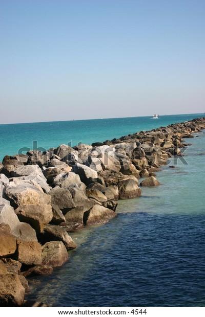 rocky water barrier in ocean