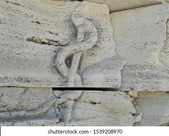 the Rod of Asclepius ancient roman bas-relief on Tiber Island in Rome, Italy