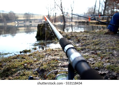 Rod eyelet, spring feeder fishing on Czech lake, waiting for wild animal in nature, relaxing with mate, chilly day