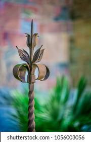 Rod iron garden art with blurred background