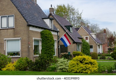 RODEN, NETHERLANDS - MAY 05, 2015: House with Dutch flag hung during the remembrance of the dead.  It commemorates all Dutch people who have died in wars since the outbreak of World War II.
