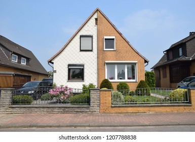 Rodenberg, Germany - May 10, 2018: Two house halves with different facade design