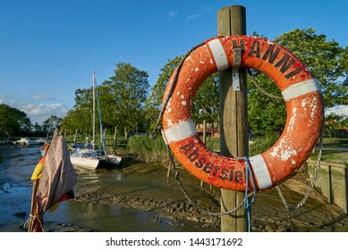 """Rodenkirchen, Germany - July 03, 2019: vintage life-ring of the historic floorboard ship """"Hanni"""" in front of the Abser Siel on a sunny summer day with blue sky"""
