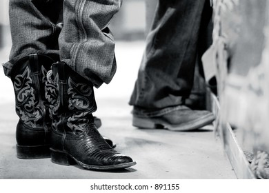Rodeo bull rider's boots behind the scenes - steel black and white effect.