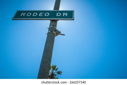 Rodeo Drive Strret sign in Beverly Hills sunlight 2013
