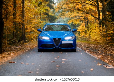 Rodewisch, Germany - September 7, 2018: driving through a  autumnal landscape with the Alfa Romeo Giulia Veloce