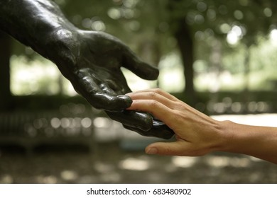 Rodin statue with sensitive human hands in a garden of the Rodin Museum, Paris, France.