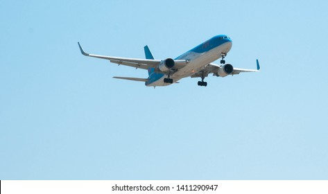RODOS, GREECE - AUGUST 10, 2018: Passenger plane of German airline Tui in the sky, Rhodes, Greece
