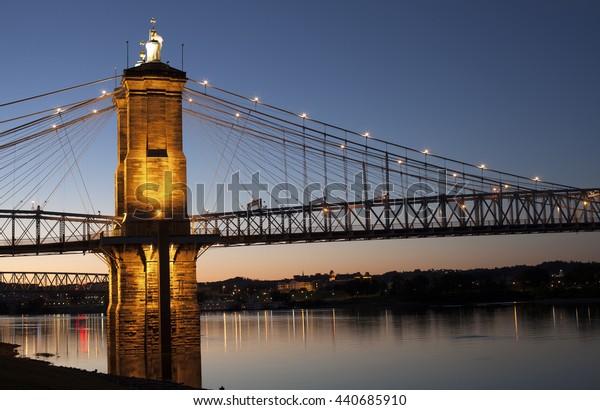 Roebling suspension bridge tower at night