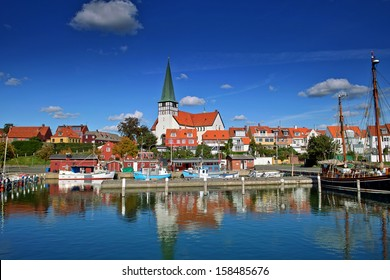Roenne harbor and church seen from the sea, Bornholm, Denmark