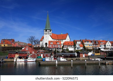 Roenne harbor and church seen from the sea, Bornholm, Denmark.