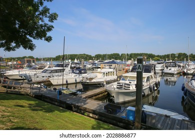 Roermond (Marina resort Oolderhuuske), Netherlands - July 9. 2021: View on inland harbor at river Maas with yachts against blue summer sky