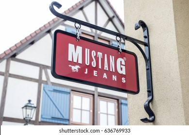 Roermond Netherlands 07.05.2017 Logo of the Mustang jeans Store in the Mc Arthur Glen Designer Outlet shopping area