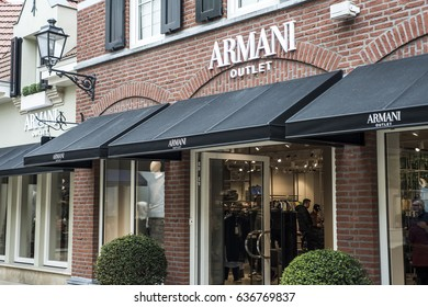 Roermond, Netherlands 07.05.2017 Logo and shop of Armani Store Mc Arthur Glen Designer Outlet shopping area