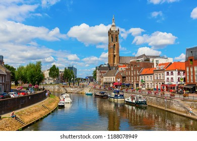 Roermond, Netherlands - August 14, 2018: Cityscape with river Roer and unidentified people. Roermond received town rights in 1231. The town centre has been designated as a conservation area