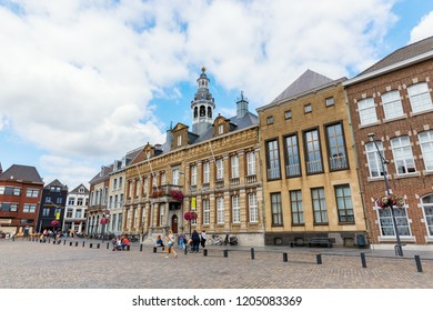 Roermond, Netherlands - August 14, 2018: buildings at the city square and unidentified people. Roermond received town rights in 1231. The town centre has been designated as a conservation area